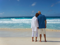 Couple enjoying retirement at the beach